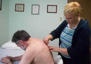 Janice doing back IMS treatment